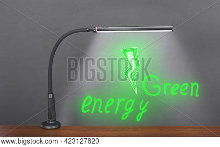 Flexible Modern Table Led Light Shines On A Drawn Green Electric Bolt With The Inscription