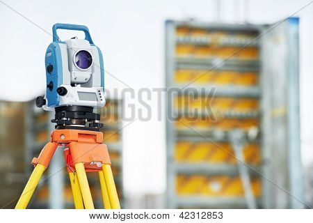 Surveyor equipment tacheometer or theodolite outdoors at construction site