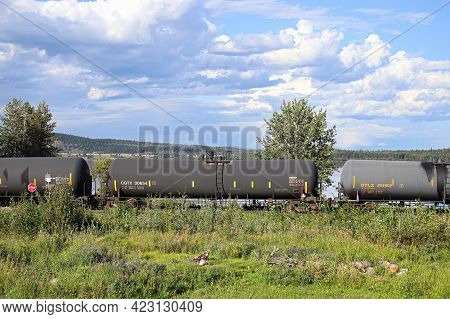 Fraser Lake, Canada - August 8, 2019: A Train Travels Along Faser Lake Carrying Liquids, British Col