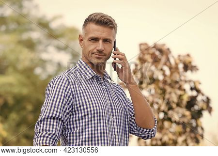 Standing By For A Call. Handsome Man Make Phone Call Outdoors. Call Answering. Incoming Call. Phone
