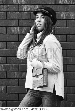 Beautiful Stylish Woman Walking In Pink Jacket. Wearing Trendy Hat Headwear. Street Style. Spring Fa