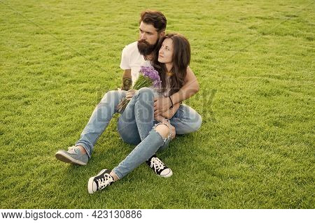 Turning Family Vacation Into Honeymoon. Couple In Love Sit On Green Grass. Summer Vacation. Enjoying