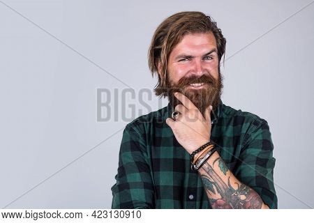 Male Beauty And Fashion. Barbershop Concept. Copy Space. Bearded Man In Checkered Shirt. Casual Guy