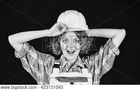 Portrait Of An Industrial Engineer. Girl Working Engineering In Industry. Female Engineer In Hardhat