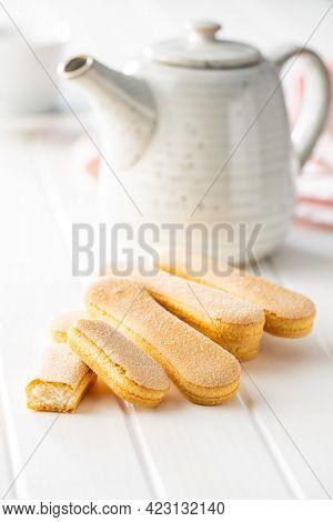Italian cookie savoiardi. Sweet biscuits. Sponge cookies tiramisu on white table.