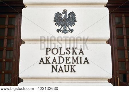Warsaw, Poland, Nov 15, 2018: Coat Of Arms Of Poland And Plate Of Polish Academy Of Sciences On The