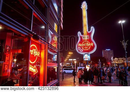 Warsaw, Poland, Nov 17, 2018: Neon Light Logo Of Hard Rock Cafe And Exterior Near Palace Of Culture