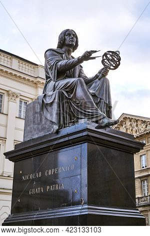 Warsaw, Poland, Nov 15, 2018: Nicolaus Copernicus Monument In Front Of Staszic Palace, Seat Of The P