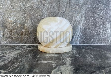 A Close-up Onyx Candle Holder Stands On A Grey Marble Table