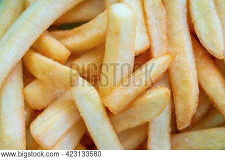 Close-up, Selective Focus And Flat Lay Of French Fries. Background Of Junk And Fast Food. Unhealthy