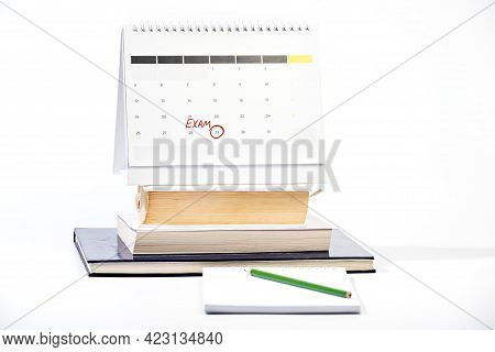 Learning For Exam Concept With Mark On The Calendar - Red Circle Marking Exam Date On Calendar Sheet