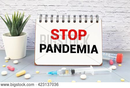 Text Stop Pandemia On White Paper, Concept