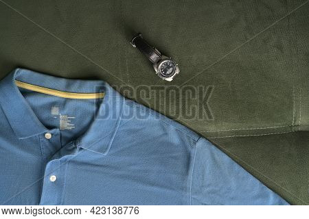 Moscow, Russia - June 8 2021: A Blue Polo Shirt And A Watch Designed For Anglers. Hipster Fashion. F
