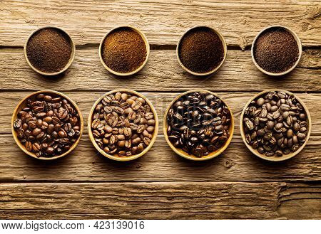 Coffee Beans In A Bag And Ground Coffee In A Cup On A Wooden Table With Space To Copy. Top View, Cop