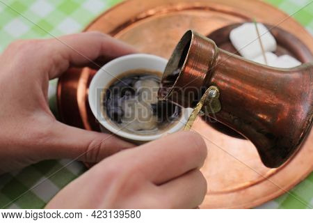 Close Up Of Woman Hands Serving  Turkish Coffee. Table Set With Greek Or Turkish Coffee