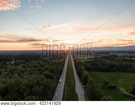 Aerial View Of Trans-canada Highway 1 In Fraser Valley During Colorful Spring Sunset. Greater Vancou