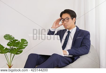 Asian Financial Advisor Wear Glasses Using Laptop And Headache With Working In Home Office. Business