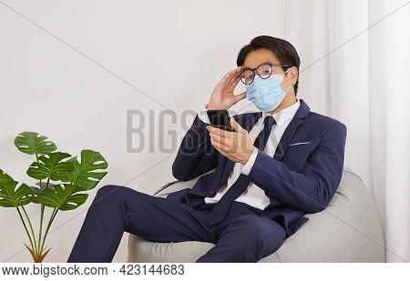 Asian Financial Advisor Wear Face Mask And Glasses Headache From Stress In Home Cafe Office.business