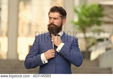 Mature Man In Jacket Fix Tie Walking Outdoors. On The Way To Office. Modern Life Fashion. Businessma