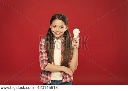 Childrens Creativity And Inspiration. Happy Childhood. Teen Kid Showing Lamp Bulb. Girl Lighting Lam