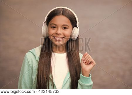 Happy Child Wear Headphones. Listen To Music. Back To School. Online Private Education. Smiling Kid