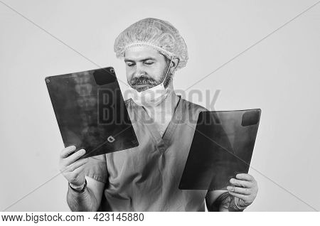 X-raying Health Problems. Nurse Checking X-ray Film At Hospital. Analyzing Chest X-ray In Examinatio