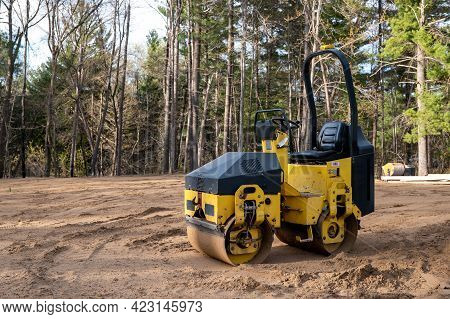 Small Yellow Compactor Roller, A Machined Used For Compaction Of Soil, Asphalt Surface, Gravel And S