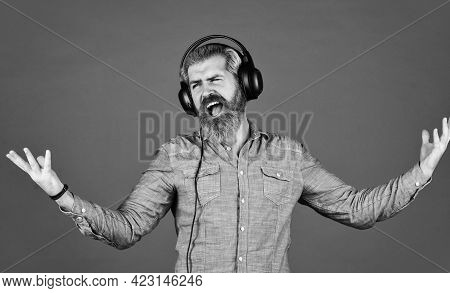 Bearded Man Hipster In Headset. Listening To Music. Time To Relax. Brutal Hipster Wear Earphone. Sin