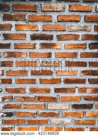 Close-up Of Orange Brick Wall And Peeled Paint Caused By Water And Sunlight. Peel Wall Of White Hous
