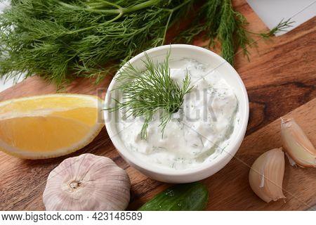 Traditional Greek Dip Sauce Or Dressing Tzatziki Prepared With Grated Cucumber Sour Cream Yogurt Oli
