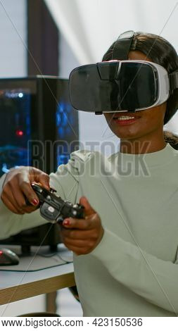 Winner Player Holding Joystick Playing Videogame In Gaming Room Using Virtual Reality. Professional