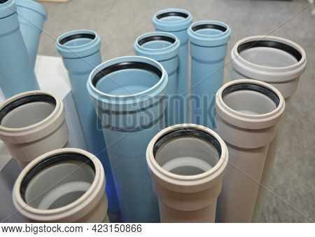 The Display Of Plastic White And Blue Sewer Pipes, Underground Drain Pipes In A Shop. Choosing Pvc S