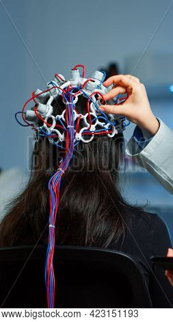 Woman Patient Wearing Performant Eeg Headset Scanning Brain Electrical Activity In Neurological Rese