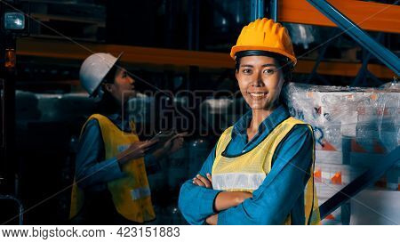 Portrait Of Young Woman Warehouse Worker Smiling In The Storehouse . Logistics , Supply Chain And Wa