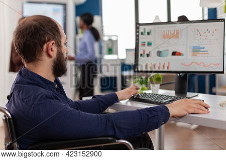 Paralysed Immobilized Invalid Worker With Disabilities Working At Computer Analysing Financial Stati