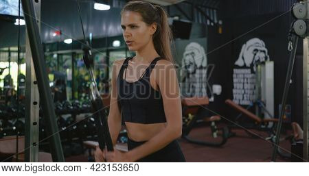 Muscular Woman Working Out Exercise For Triceps Push Down Weightlifting With Pull Cable Cross Machin