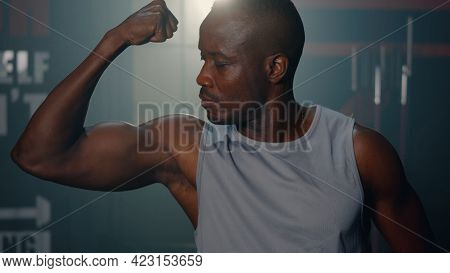 Portrait Of Handsome Fitness Black Man In Gym, Personal Trainer Show His Muscular Different Movement