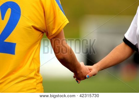 Two athletes handshake after the mach