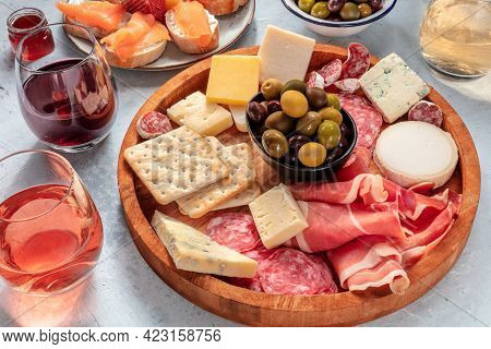 Charcuterie And Cheese Board With Wine And Olives. Italian Antipasti. Blue Cheese, Parma Ham, Salami