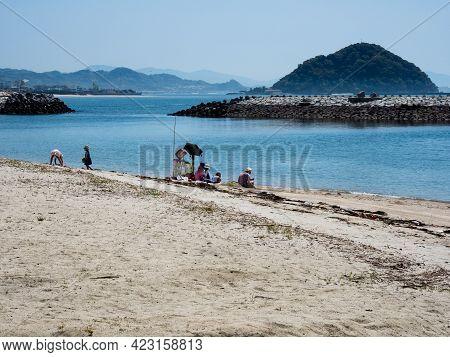 Matsuyama, Ehime Prefecture, Japan - April 11, 2018: Families Relaxing At The Beautiful Beach At Roa