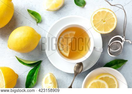 Lemon Tea In A Cup, Overhead Flat Lay Shot With Organic Lemons And Green Leaves. Tasty Citrus Detox