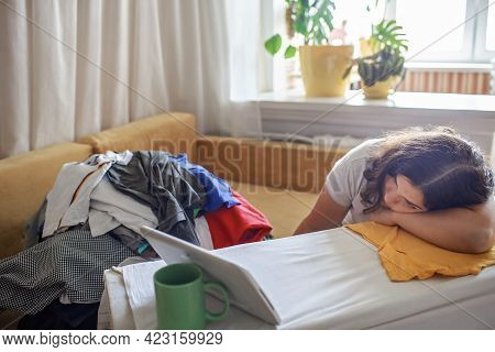 Tired Middle Aged Woman Watches Video On Tablet And Ironing Things At The Same Time, Daily Routine,