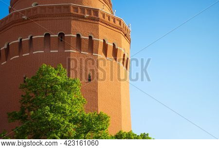 Part Of The Red-brick Moscow Kremlin Building. The Tower Of The Moscow Kremlin On The Background Of