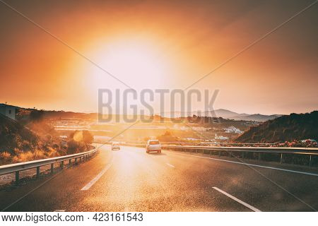 Movement Of Vehicles On Freeway, Motorway Near Malaga In Spain. Sunset Time