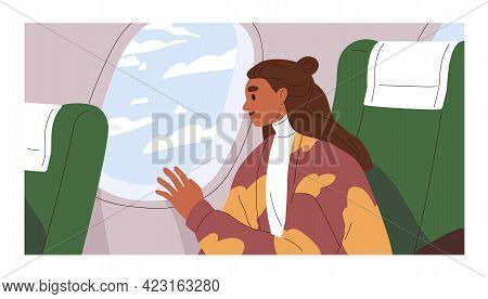Passenger Traveling By Air Plane, Looking Outside Porthole At Sky With Clouds. Happy Woman Sitting B