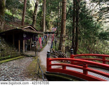 Kumakogen, Ehime Prefecture, Japan - April 10, 2018: Red Bridge And Buddhist Pavilion On A Mountain