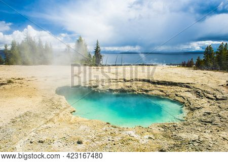 Deatiled photo of a turquoise thermal pool from above. West Thumb Basin. Yellowstone National Park, Wyoming, USA