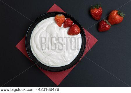Plain Yogurt With Strawberries, Red Napkin And Black Background