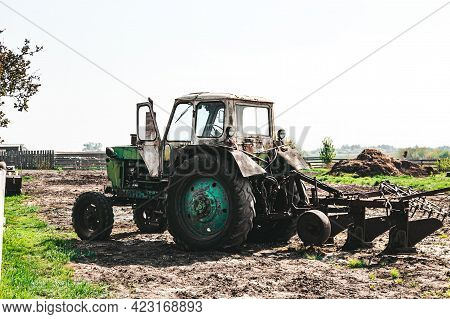 Agricultural Seasonal Work, A Tractor Plows The Land For Sowing Seedlings, Horizontal Photo On A Sun