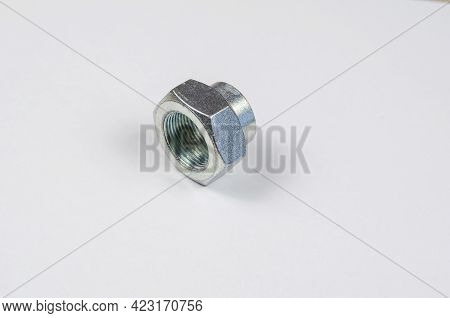 Hub Nut On White Background. New Silver Front Car Hub Nut. Auto Parts.